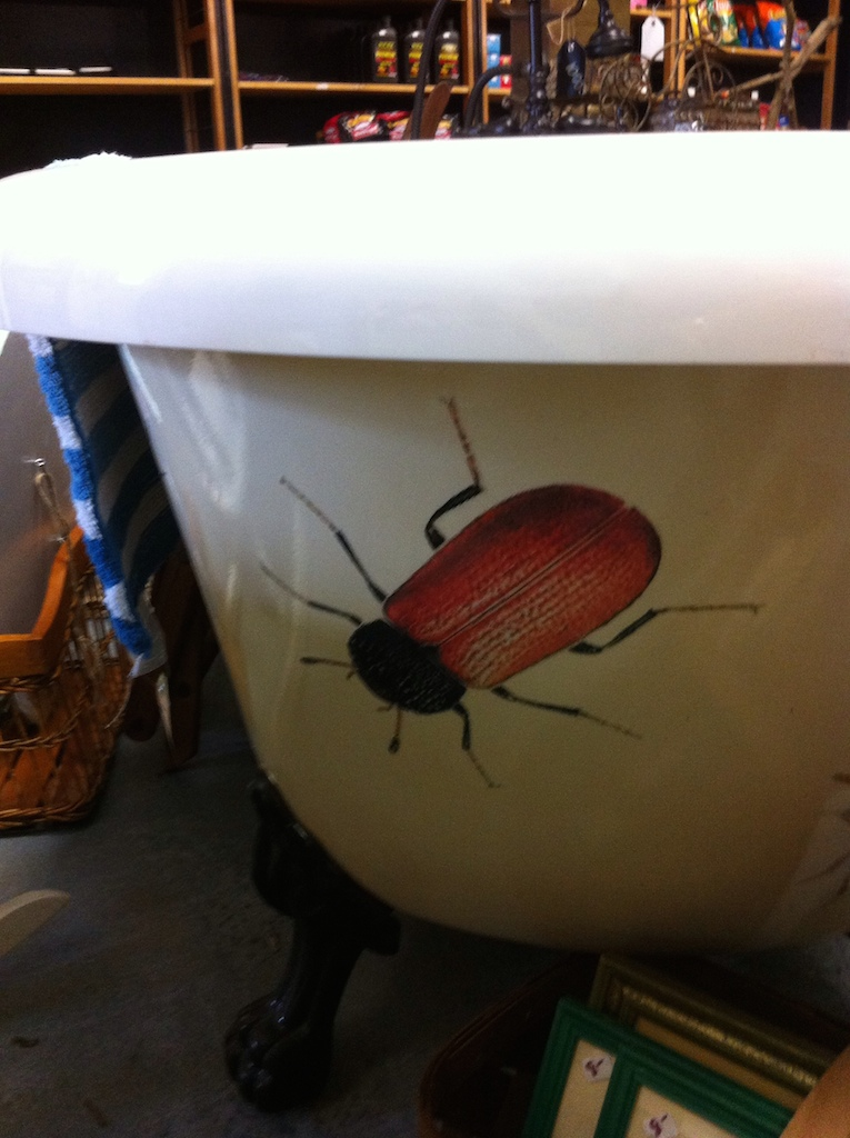 A claw-foot tub with,...bugs on it ! LOL